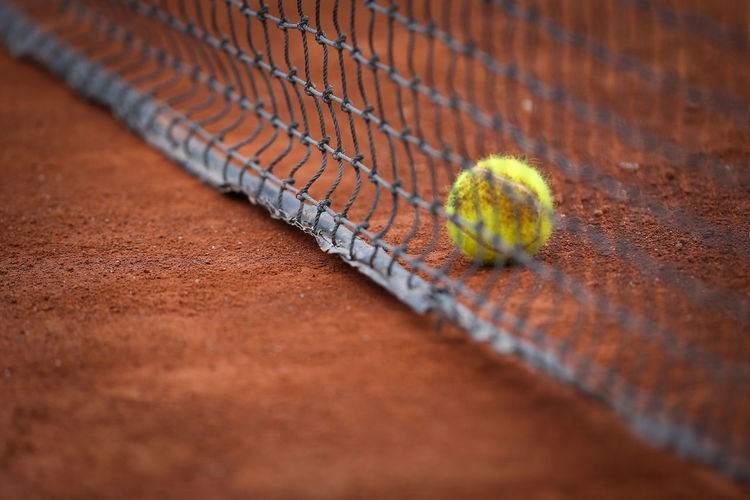 High angle view of tennis ball and net on field