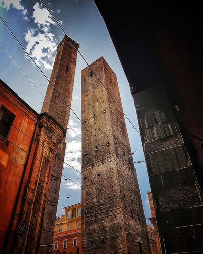 Low Angle View Skyscraper Architecture Day Sky Built Structure Outdoors No People Building Exterior City Travel Vacation Travel Destinations History Street High Angle View Streetphotography Bologna Centro Bologna Centre Bolognadavivere Asinelli Tower  Tower Landscape_Collection Architecture Landscape