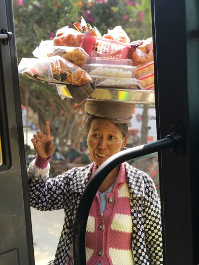 Woman in Myanmar Selling On The Street Selling Cultures Myanmar Culture Localfood Locallife One Person Day Hat Real People Waist Up Representation Transparent Holding Portrait