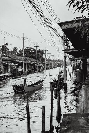 Architecture Black And White Boats Business Day Electrical Wires Electricity Pylon Floating Market Gondola - Traditional Boat Houses Lifestyles Mode Of Transport Monochrome Nautical Vessel No People Outdoors Reflection Riverside Sky Traditional Culture Transportation Travel Destinations Water Water Canal Water Road