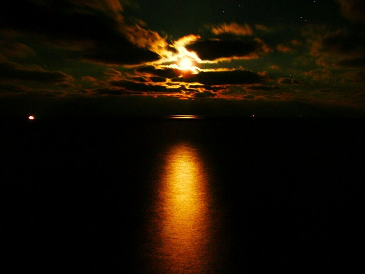 Night Sea Reflection Beauty In Nature Nature Water Idyllic Scenics Outdoors Sky Horizon Over Water Astronomy Sunset Sea Cloud - Sky Moon Night Space No People