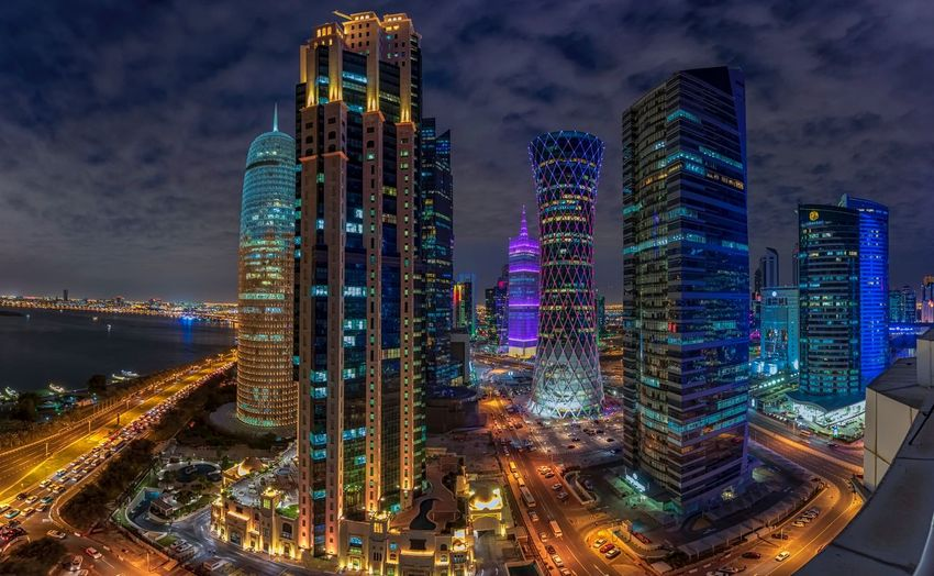 Doha Night Cityscape Building Exterior Built Structure Architecture Illuminated City Office Building Exterior Skyscraper Financial District  Night Building Cityscape Sky Modern Tall - High Tower Urban Skyline Landscape Lighting Equipment
