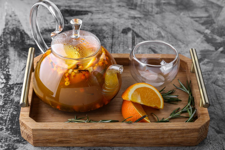 Citrus Fruit Container Drink Drinking Glass Food Food And Drink Freshness Fruit Glass Healthy Eating Herb Herbal Tea Hot Drink Household Equipment Indoors  Jar Lemon No People Pitcher - Jug Refreshment Tea - Hot Drink Wellbeing Wood - Material