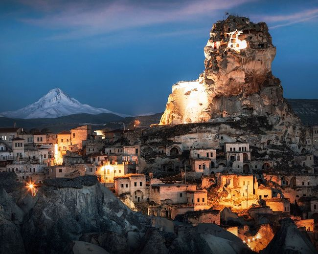 Mt Erciyes and Cappadocia Mount Erciyes Cappadocia Blue Hour Building Exterior Architecture Built Structure Building Illuminated Snow Cold Temperature Nature Winter Night Sky City No People Mountain Travel Destinations House Travel Tourism Outdoors