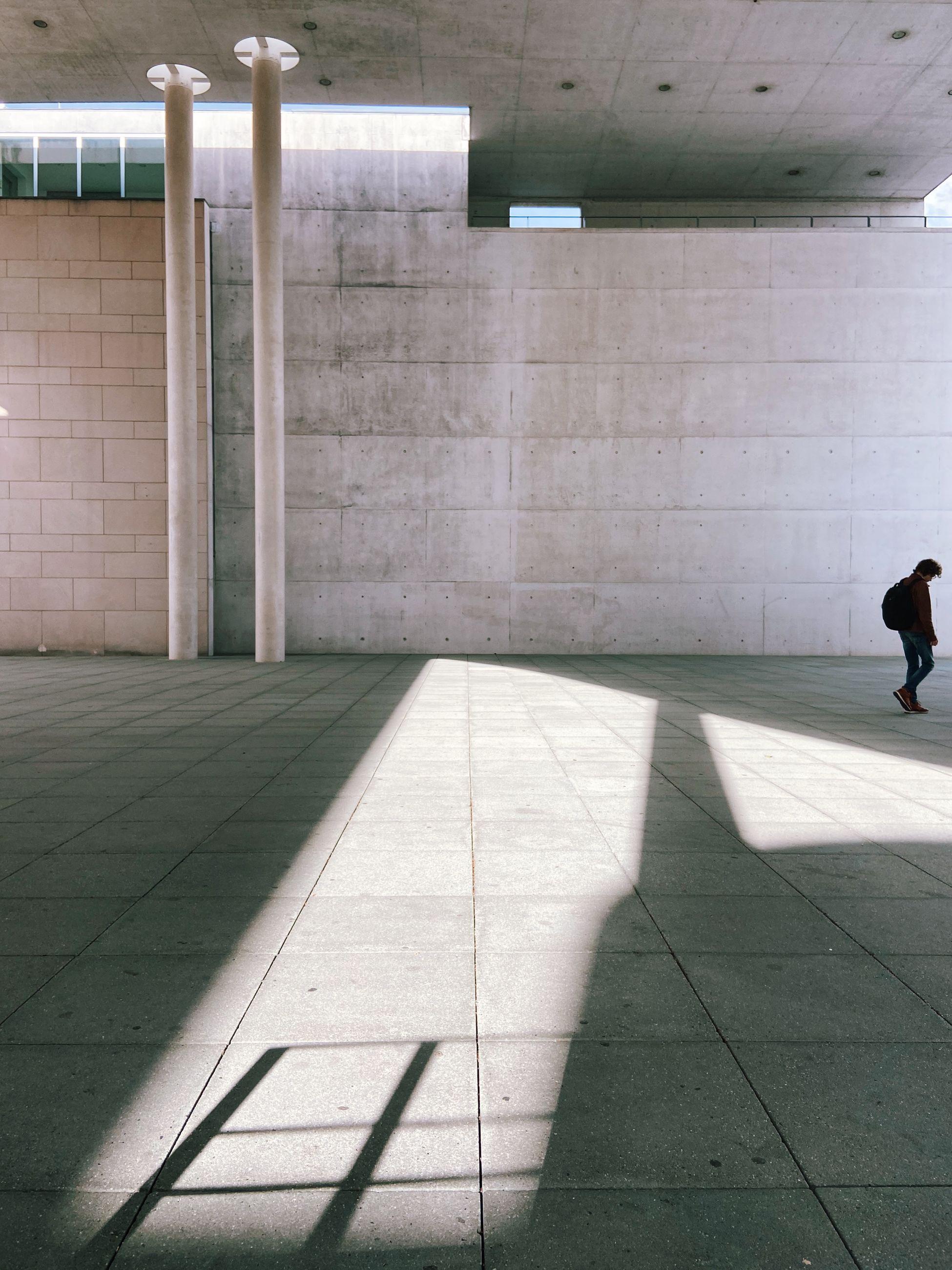 SHADOW OF MAN WALKING ON SUBWAY
