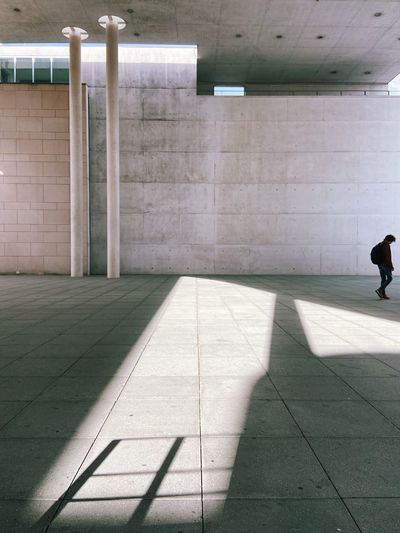 Shadow of man walking in subway