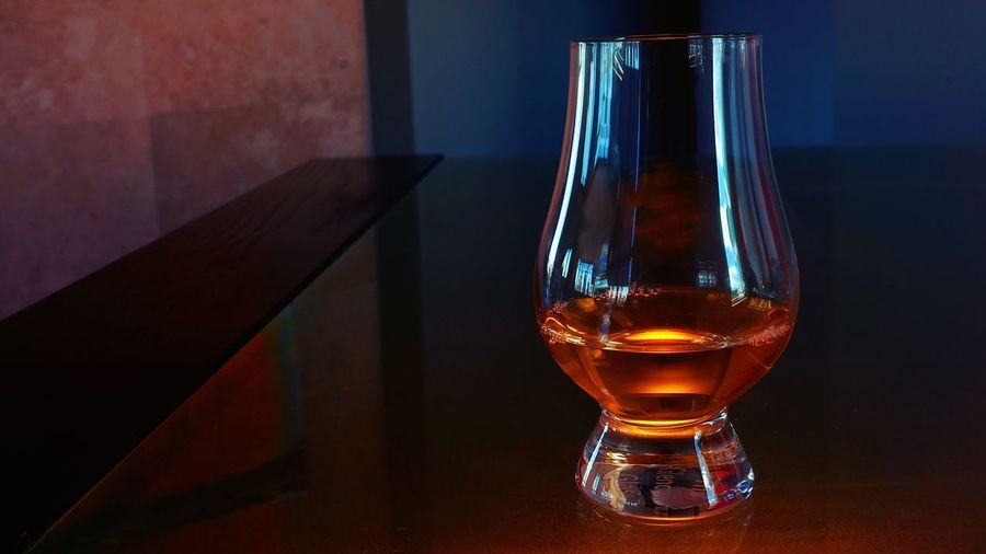 Close-up of scotch whiskey in glass on table