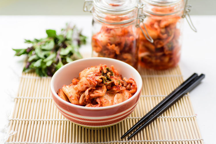 Kimchi cabbage Eating Homemade Food Kimchi Korean Food Spicy Food Asian Food Bowl Cabbage Chopsticks Close-up Container Fermentation Food Food And Drink Freshness Healthy Eating Jar Pickle Probiotic Ready-to-eat Still Life Table Vegetable