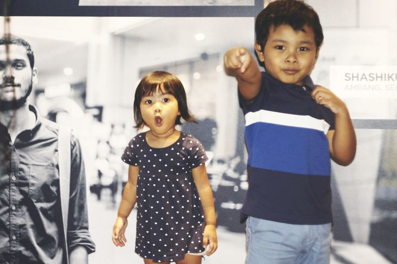 Portrait of siblings standing