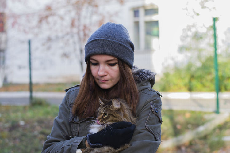 Adult Adults Only Beautiful People Beautiful Woman Beauty Cat Day Disappointment Domestic Animals Domestic Cat Human Hair Knit Hat Long Hair Mourning One Person Outdoors People Pet Pets Warm Clothing Young Adult Young Women Pet Portraits