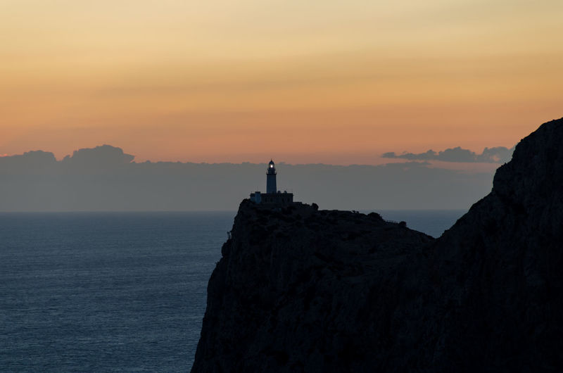 Beauty In Nature Calm Cap De Formentor Cliff Guidance Lighthouse Majestic Mallorca Mountain Nature Ocean Orange Color Outdoors Rock - Object Rock Formation Scenics Sea Silhouette Sky Sunset Tranquil Scene Tranquility Vacations Water Waterfront
