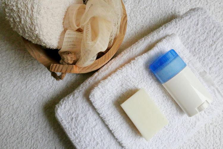 High Angle View Of Bathing Products On Towel