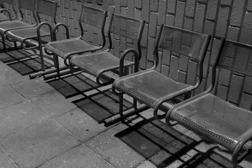 Street Seat Empty Chair Absence Metal No People Day High Angle View Architecture In A Row Arrangement Furniture Outdoors Relaxation Sidewalk
