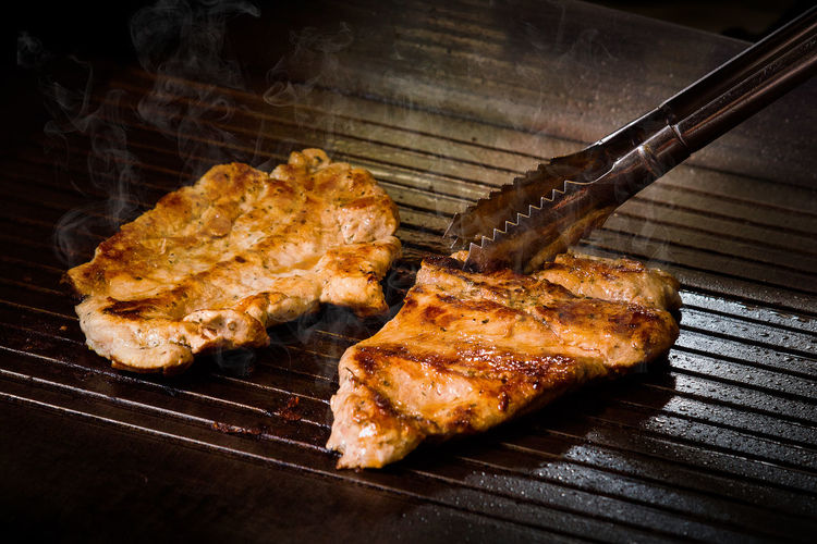 Grilled beef steak on a hot plate Barbecue Brown Close-up Eating Utensil Food Food And Drink Freshness Grilled Heat - Temperature High Angle View Indoors  Indulgence Kitchen Utensil Meat Metal No People Preparation  Ready-to-eat Still Life Temptation Wellbeing White Meat