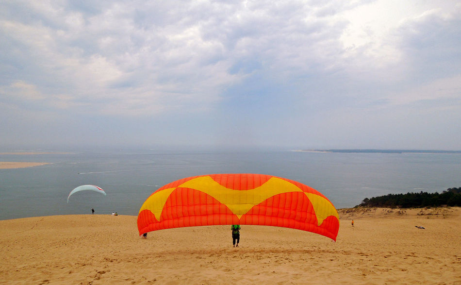 Adventure Beach Clouds And Sky France Freedom La Grande Dune Du Pyla Like A Bird Orange Color Outdoor Activities Paragleiter Paragliding Sand Dune Sports Summer Water_collection