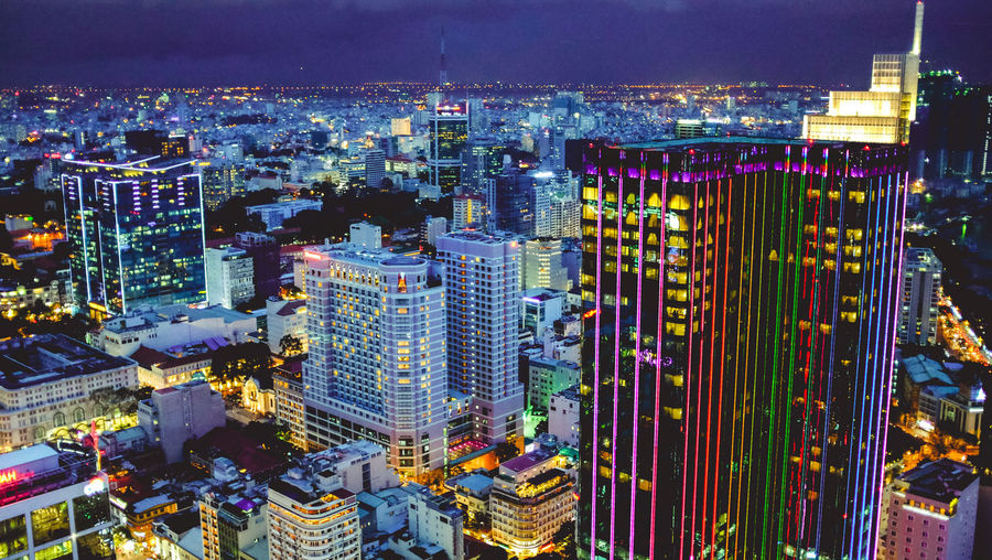 High Angle View Of Illuminated Modern Buildings In City Against Sky