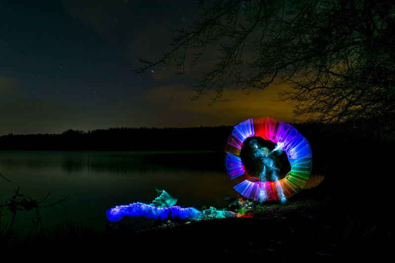 Ghost Beauty In Nature Illuminated Lake Lightpainting Lightsaber Nature Night One Person Outdoors Real People Sky Tree Water