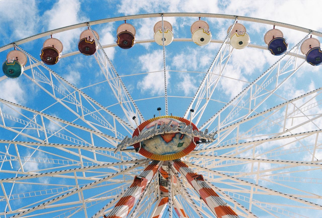 ferris wheel, low angle view, amusement park, amusement park ride, arts culture and entertainment, sky, no people, day, blue, outdoors, architecture, close-up