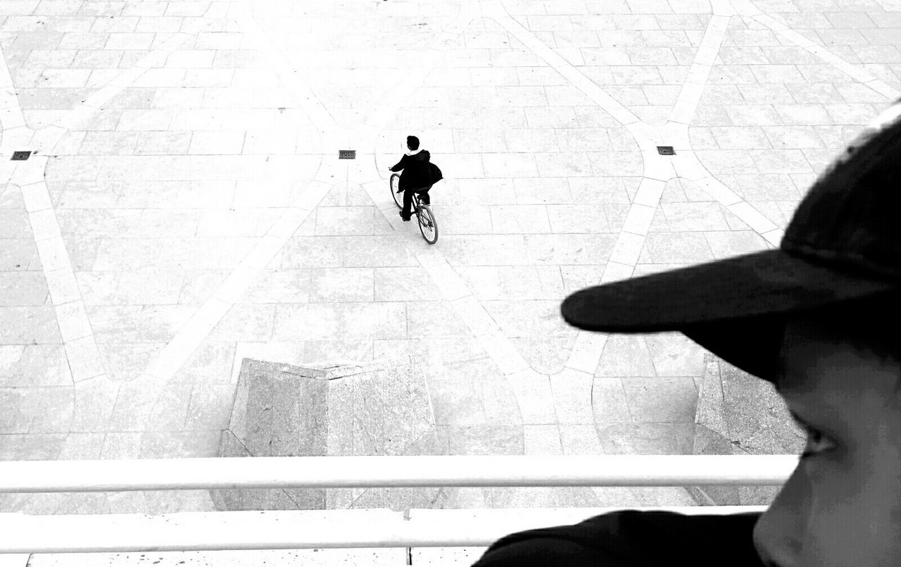 Cropped image of boy with man riding bicycle on street