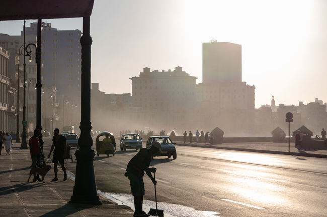Malecon Adult Architecture Backlit Cars City Cityscape Cleaning The Street Coco Taxi Cuba Cuba Collection Cuban Life Day Lamppost Outdoors People Reflection Silhouettes Tourist Attraction  Travelling Photography Urban Skyline