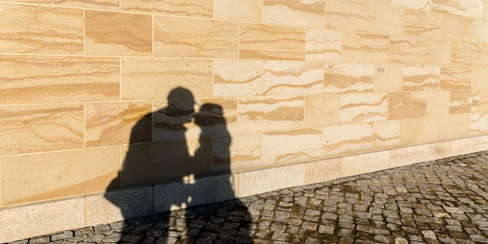 Shadow of couple on wall