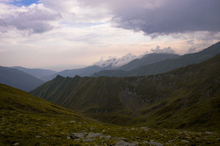Scenic view of fagaras mountains against cloudy sky