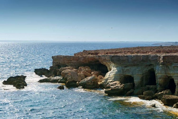 Sea caves at capo greco outside aia napa on cyprus. Sea Rock - Object Nature Beach Landscape Water Blue Travel Destinations Clear Sky Outdoors Wave Seacave Cyprus Aianapa Mediterranean  Ovean View
