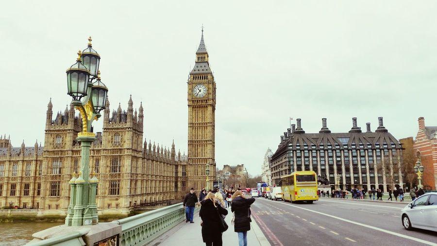People walking on westminster bridge by big ben