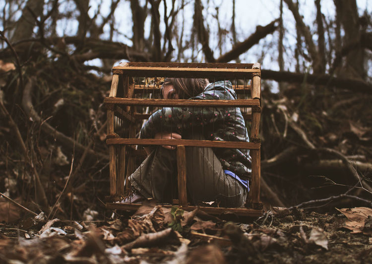 Stuck In A Cage Self Portrait Nature Portrait person Female Hiding Cage Leaves Fall Autumn Brown Brown Hair Tiny EyeEm Selects Tree Forest Close-up Landscape Branch Woods Fallen Leaf Dead Plant Dried Plant Wilted Plant Fallen Tree Trunk Bare Tree