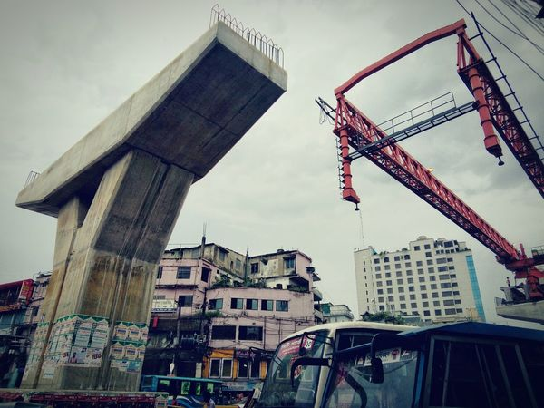 Chittaagong, at the center of the city Architecture Built Structure Building Exterior Development City Low Angle View Crane - Construction Machinery Construction Site Sky Cloud Progress Outdoors Construction Day Tall - High Tall Cloud - Sky City Life Flyovers Vintage Style Mobilephotography Street Photography Eye4photography  Urban Geometry EyeEm Bangladesh