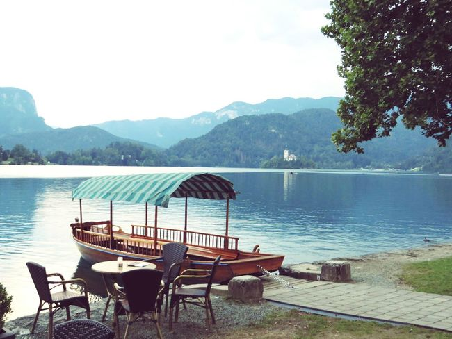 """Coffe time"" in wonderfullworld Slovenia Mountain Water Chair CoffeTime Lake Nature Relaxation Scenics Beauty In Nature Travel Destinations Landscape Eye4photography  EyeEm Gallery Green Color EyeEmBestPics Travelshots"