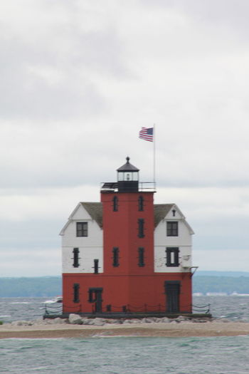 Architecture Building Exterior Built Structure Cloud - Sky Day Flag House Lighthouse Lighthouse Cruise Lighthouse_lovers No People Outdoors Round Island Lighthouse Sea Sky Water