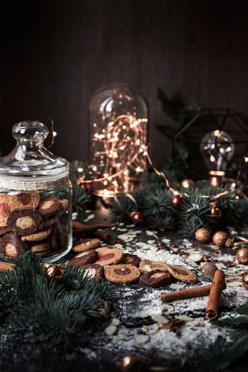 Illuminated decorations and cookies on table