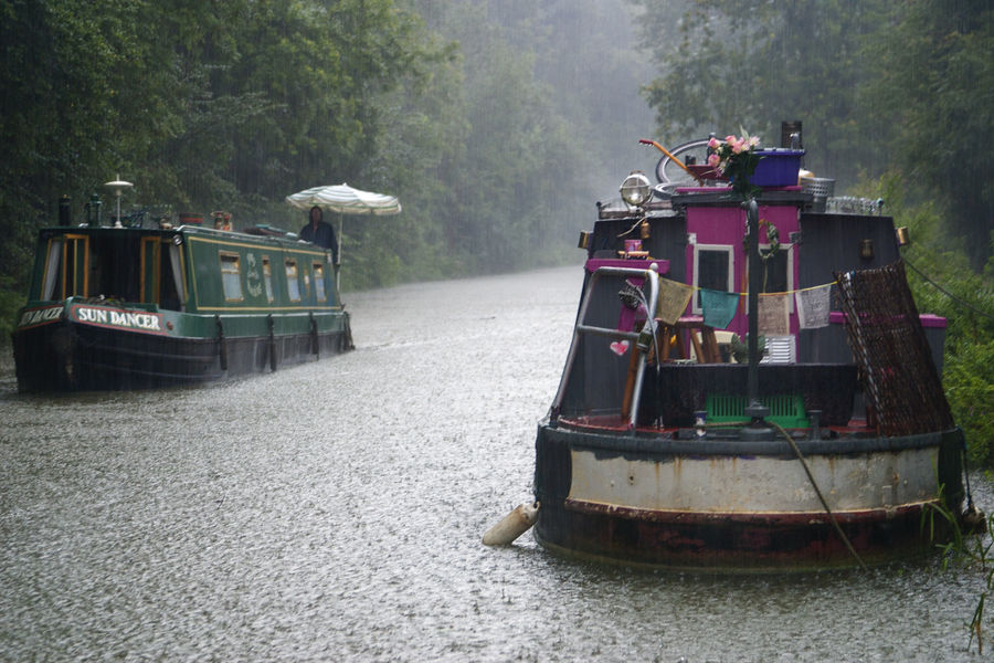 Sun Dancer Alternative Lifestyle Beauty In Nature Boat Canals And Waterways England English English Countryside Enjoying Life EyeEmNewHere Journey Kennet And Avon Canal Liveaboard Narrowboat Off Grid Prayer Flags  Rain Rain On Water Rainy Days Travel Traveling Umbrella Wet Weather