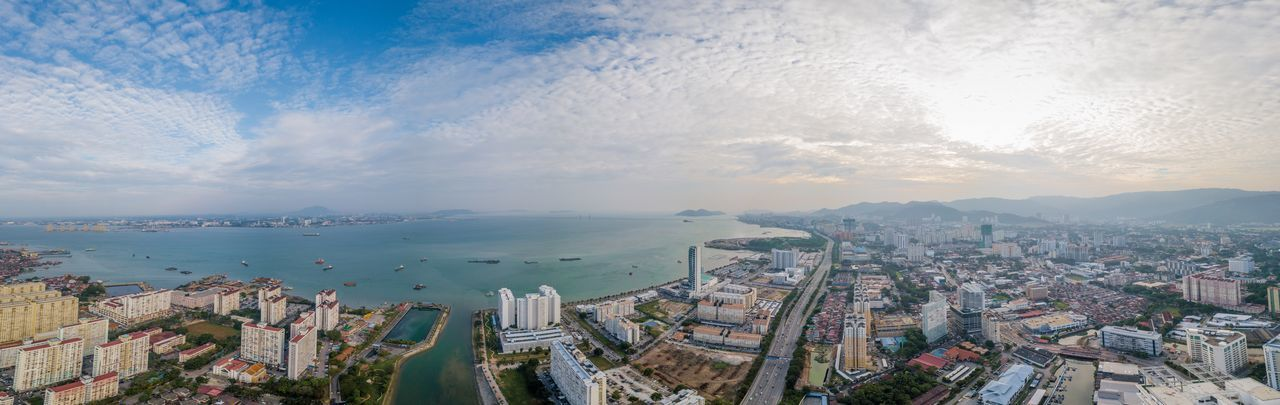 The view of penang kapal singh Sea Blue Sky Malaysia Scenery Kapal Singh Drive Seascape Sea And Sky Penang Dronephotography Drone  Architecture Cityscape Building Exterior City Built Structure High Angle View No People First Eyeem Photo