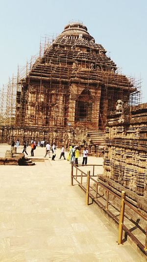 Konark temple Travel Destinations Architecture Religion Ancient Civilization History Travel Built Structure Vacations Tourism Ancient Pyramid Spirituality Day Old Ruin Building Exterior Outdoors Clear Sky Sky People Adult