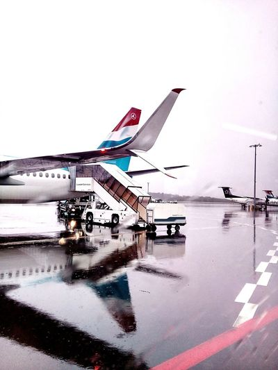 Water Reflections Reflections Liquid Lunch Typical Happy Shots Grey Sky Rain Rainy Days Findel Airport Luxembourg Airport Runway Airport Life