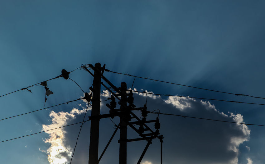Electricity  Low Angle View Power Supply Cable Power Line  Connection No People Fuel And Power Generation Technology Sky Electricity Pylon Outdoors Day Nature Beauty In Nature Scenics Artistic Blue Frame Composition Rays Of Light Rays Rays Of Sunlight Rays