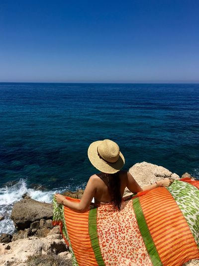 Cyprus Summertime Back View Of Girl Beach Beauty In Nature Clear Sky Hat Horizon Over Water Lifestyles Nature One Person Pafos Relaxation Scenics Sea Shore Summer Sun Hat Sunhat Vacations Water Wind Women Young Women