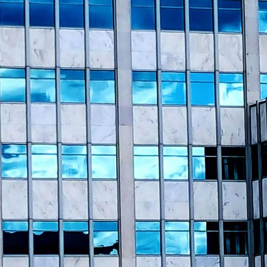 When buildings become art Architecture Blue Window Building Exterior Built Structure Pattern Reflection Modern No People Outdoors Close-up Building Feature Fine Art Photography Building And Sky Building Structures Tadaa Community Modern Architecture Buildings Architecture Architectural Feature Adapted To The City