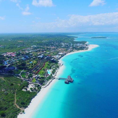 Sea Blue Water Sky Nature Beach Travel Destinations Travel Aerial View Horizon Over Water Beauty In Nature Scenics Vacations Outdoors Landscape Cloud - Sky Horizontal Swimming Pool No People Day Zanzibarisland Beauty In Nature Dronephotography Viewfromabove Shadesofblue