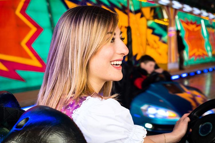 Happy woman enjoying in bumper cars