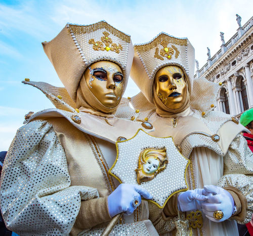 Carnival Carnival In Venice Venice, Italy Architecture Building Exterior Carnival Costumes Day Gold Colored Human Representation Idol Low Angle View Male Likeness Mask Outdoors Sky Spirituality