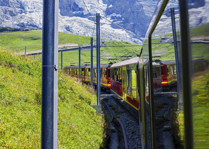 Train on railroad track amidst field