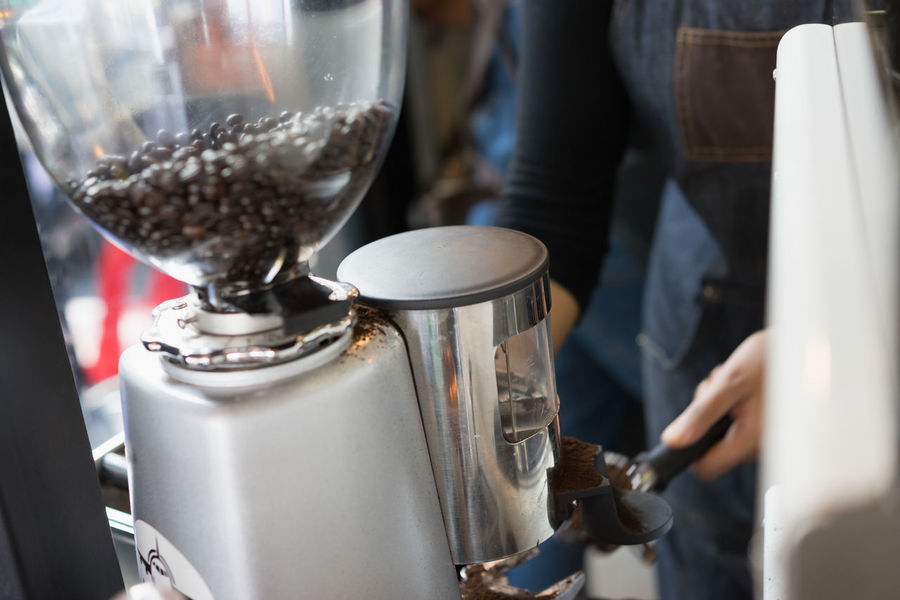 Barista is preparing is using coffee machine for made order to customer Cappuccino Adult Americano Apron Barrista Coffee Espresso Maker Human Hand Indoors  Latte Occupation One Person Part Time Job People Roasted Coffee Beans Working