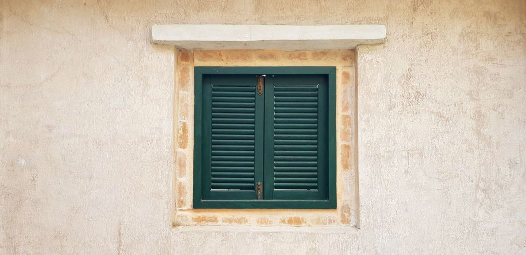 Green vintage window on wall Window Built Structure Architecture Building Exterior Day Wall - Building Feature Closed Building Protection Outdoors Security Shape Wall Safety Old Close-up Geometric Shape House Air Duct Vintage Design Art Green Color Retro Styled Wall