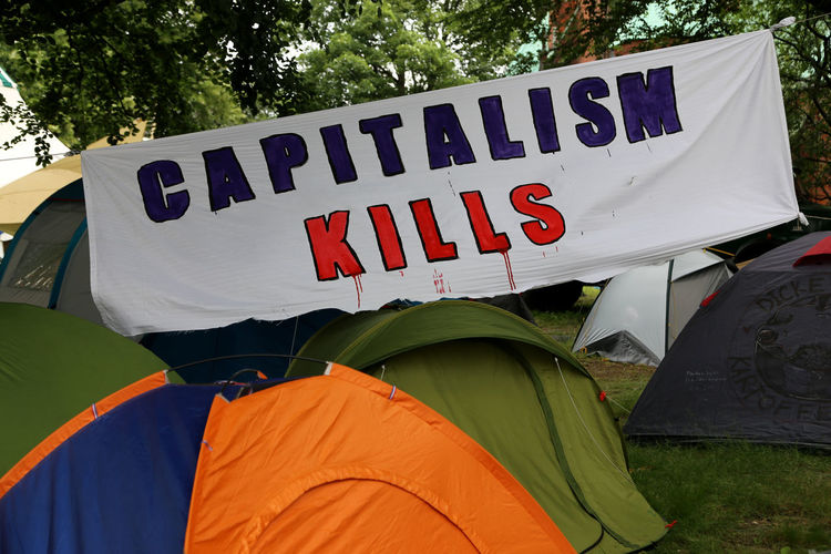 """""""Capitalism kills"""" banner in a tent camp Communication Day G20 Gipfel G20 Hamburg G20 Meeting G20 Sternschanze G20 Summit Outdoors Protest Protesting Protestor Tent Camp Tent Camping Text"""