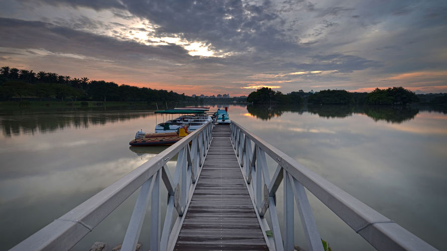 Interesting and beautiful views of the sunset on the lake Watland Putrajaya Beauty In Nature Calm Cloud Cloud - Sky Cloudy Dusk Idyllic Jetty Lake Long Majestic Narrow Nature Non-urban Scene Pier Reflection Scenics Sky Standing Water Sunset The Way Forward Tourism Tranquil Scene Tranquility Water