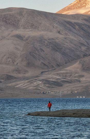 Man standing at sea shore