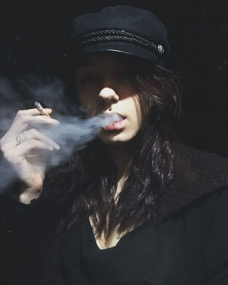 Rauchen ist tödlich. Activity Bad Habit Black Background Cigarette  Clothing Dark Hair Hairstyle Holding Leisure Activity Lifestyles One Person Real People RISK Selfie Smoke - Physical Structure Smoking - Activity Smoking Issues Social Issues Warning Sign Young Adult
